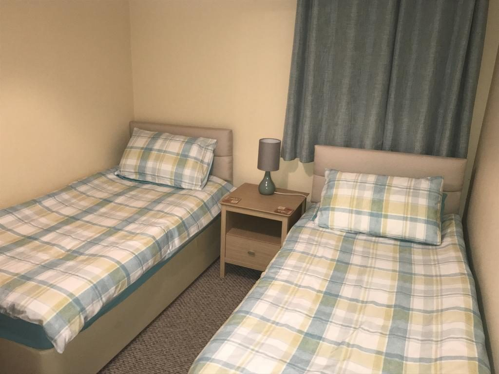 Causeway Holiday Homes single beds bedroom