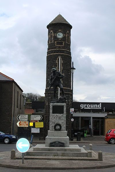 The Bushmills War Memorial in the market sQUARE WITH THE CLOCK TOWER IN THA BACKGROUND