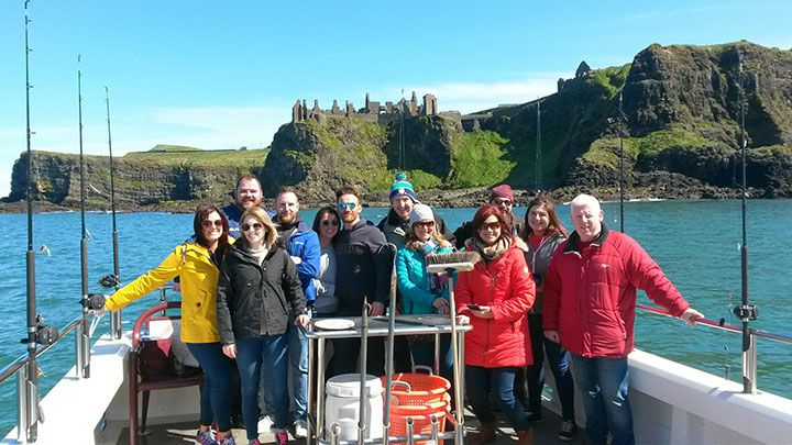 Causeway-Foodie-tours-on-the-Causeway-Lass-with-Dunluce-Castle-in-the-back-ground