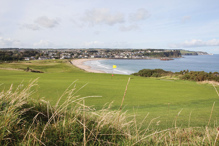 View from behind the green at Ballycastle Golf club Looking over the beacj towards the town