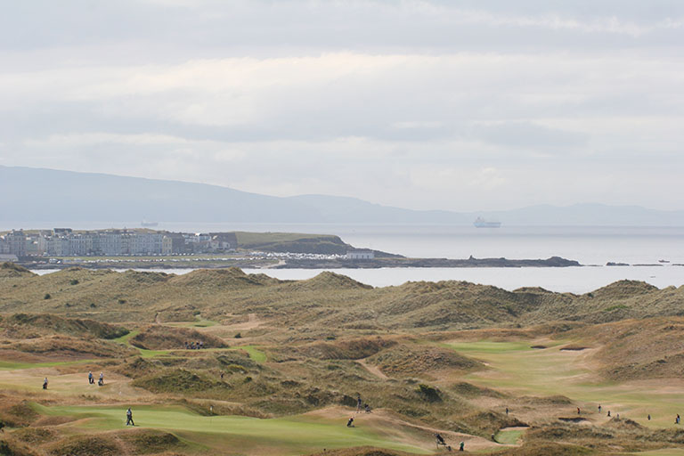 Royal Portrush Golf Club Courses taken from whiterocks with Portrush & donegal in the background