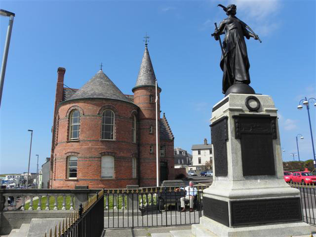 Portrush War Memorial with the Townhall in the back ground